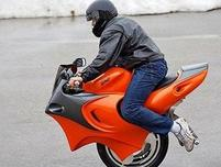 Funny picture of a man on one wheel motobike.JPG