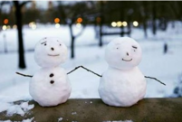 snowmen are seen on a railing at Central Park in New York.PNG
