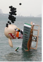 A participant falls with his structure that features Chinese Mahjong at the Red Bull Flugtag in Hong Kong 2010.PNG