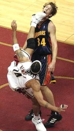 Ira Newble does a spinning kick on Mike Dunleavy Jr.jpg