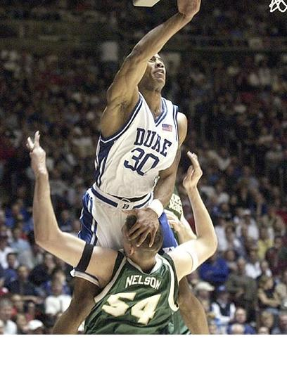 Funny photo of a Duke basketball player charging into Nelson.jpg