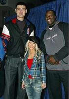 Funny photo of Yao Ming with Shaq and Christine Aguilara.jpg