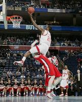 College basketball player skys over another.jpg