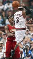 Funny Picture of Allen Iverson kicking Al Harrington in the nuts.jpg