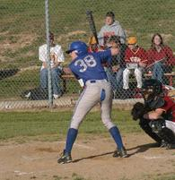 Guy rips his pants while batting in this funny baseball picture.jpg