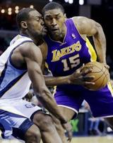 Funny picture of Metta World Peace getting a kiss from Tony Allen
