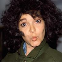 Brunette puffy hair woman makes a funny kissing face.jpg