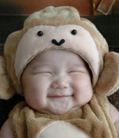 Funny baby picture of a cute baby smiling with eyes closed.PNG