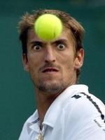 Funny Picture of a tennis player very focused on the ball.jpg
