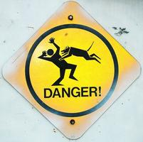 Funny danger sign of a dog jumpin gon a person.jpg