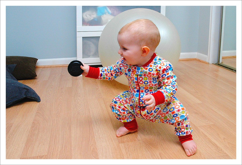 Funny picture of a baby about to chuck a black disc.jpg
