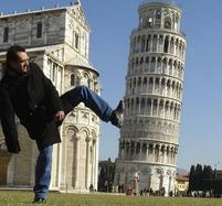 Funny perspective picture of a man pushing down the Leaning Tower of Pisa with his foot.jpg
