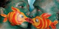 Funny pic of two people with fish face paint kissing.jpg