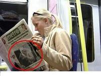 Woman reading newspaper with her on the front page.jpg