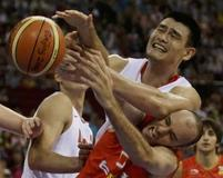 Yao Ming and Carlos Jimenez battle for the ball in this funny basketball picture.jpg