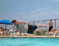 Funny photo of a fat man leaping into the pool.jpg