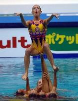 Synchronized swimmer makes a funny face expression.jpg