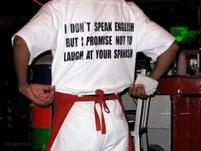 Funny waiter t-shirt that says I Don't Speak English But I Promise Not to Laugh at Your Spanish.jpg