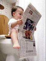 Funny photo of a baby reading the newspaper on the toilet.jpg
