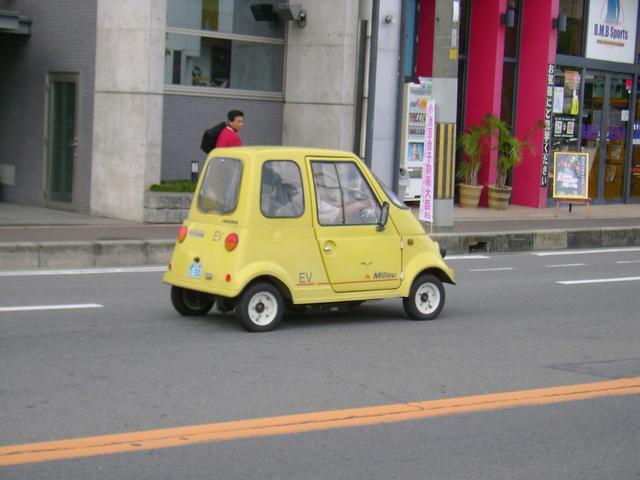 Funny looking little yellow car in Japan.jpg