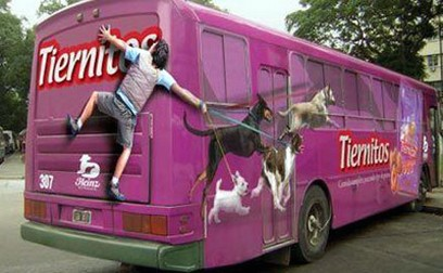 Funny bus art of a guy being dragged by his dogs.jpg