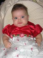 Baby girl makes a wide-eyed funny expression 2.jpg