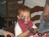 Funny pic of a baby with a chocolate hand print on his face.jpg