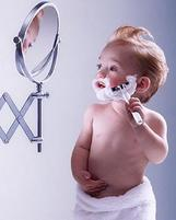 fun picture of baby shaving while using a mirror