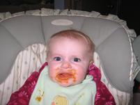 Messy baby has a funny look on her face.jpg