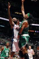 Funny basketball pic of Mikki Moore putting his hand in Baron Davis' shorts.jpg