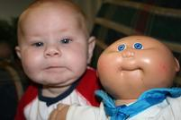 Funny picture comparing a baby to a Cabbage Patch Kid.jpg