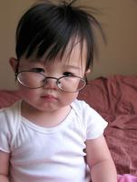 Funny pic of a baby toddler wearing glasses.jpg
