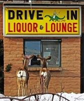 Two deer peers through a drive-in liquor store window in Medicine Bow, Wyo..jpg