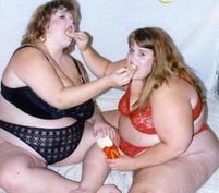 Two girls feeding each other_funny image.jpg