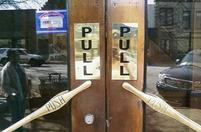 Funny door with both a Pull and pull sign.jpg