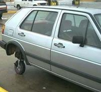 Funny photo of a car with a weak spare tire.jpg