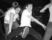 Punny picture of a guy getting kicked in the crotch by a chubby girl while dancing.jpg