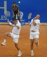 Funny picture of two tennis doubles players afraid of the ball.JPG