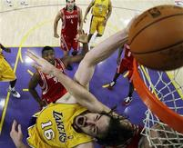 Pau Gasol makes a funny face as he is fouled by Yao Ming.jpg
