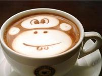 coffee cup with monkey face cream.jpg