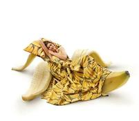 humorous photo of a woman on a banana bed.jpg