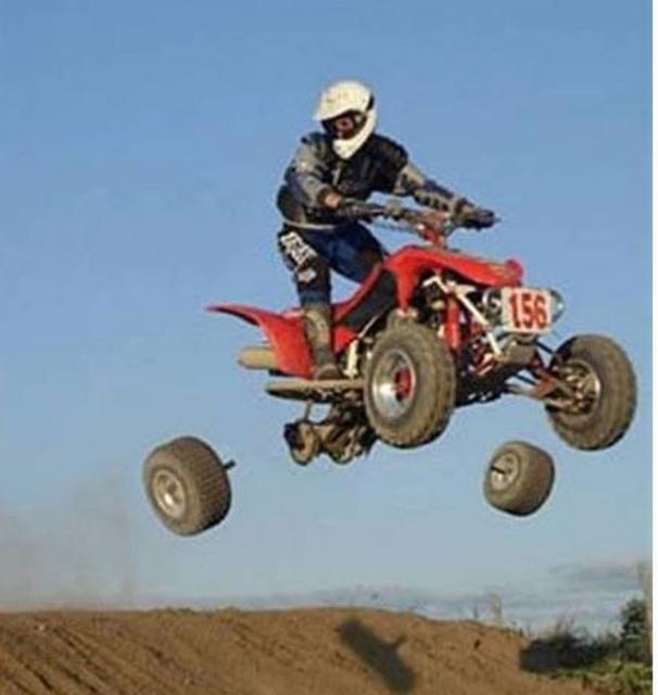 race car in the air and wheels are going apart.jpg