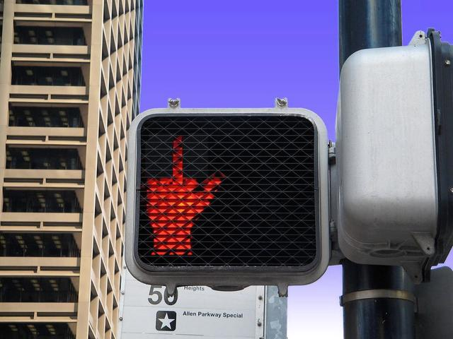 Funny middle finger don't walk sign at the intersection.jpg