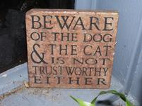 Funny sign that says Beware of the Dog and The Cat is not Trustworthy Either.jpg