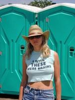 Busty woman in hat wears a funny shirt that says I Wish These Were Brains.jpg