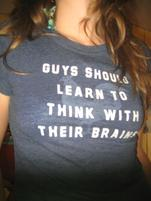 Woman wears a shirt that says Guys Should Learn to Think with their Brains.jpg
