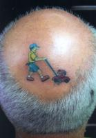Funny hairstyle with bald head with funny tatoo.JPG